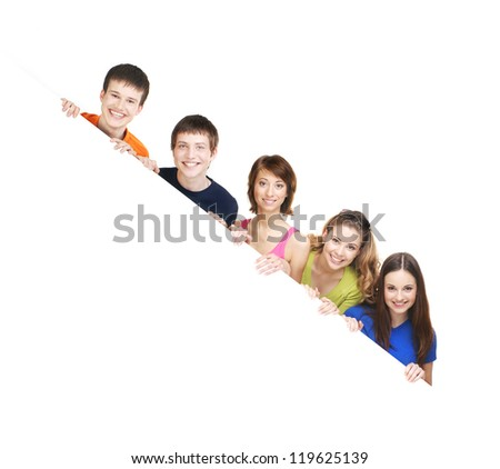 Group of teenagers with a giant, blank, white billboard - stock photo