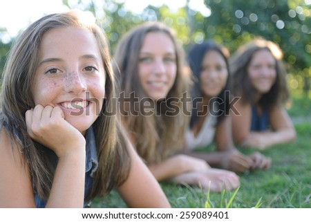 Group of teenagers with caucasian girl in front - stock photo