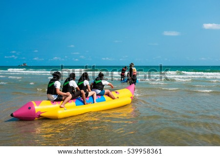 Group of teens ready for banana boat fun.
