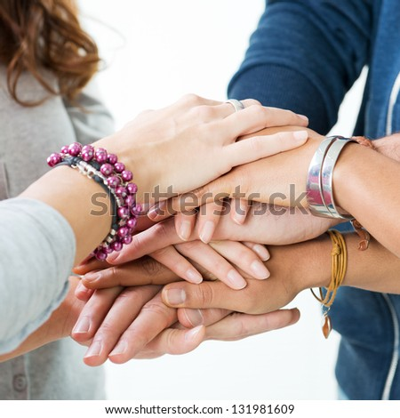 Group Of Teens Stacking Their Hands, Unity and Solidarity - stock photo