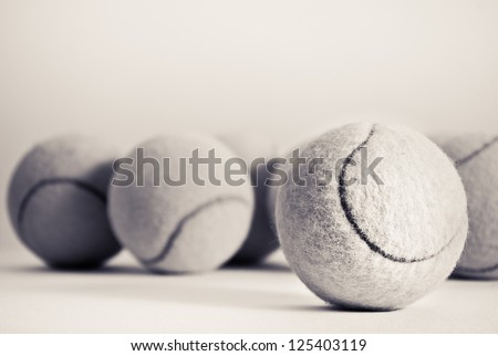 Group of tennis balls, sepia effected - stock photo