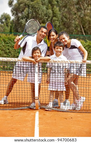 Group of tennis players of all ages at the court - stock photo