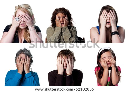 Group of terrified people hiding behind their hands - stock photo