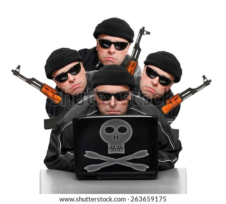 Group of terrorists with laptop and weapons. - stock photo