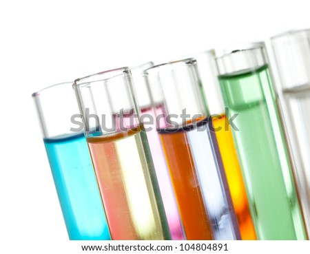 Group of test tubes with a colored liquids in a rack, isolated - stock photo