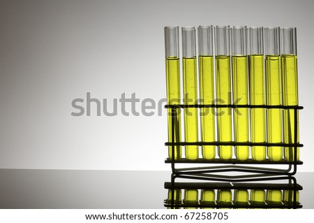 group of test tubes with yellow fluid - stock photo
