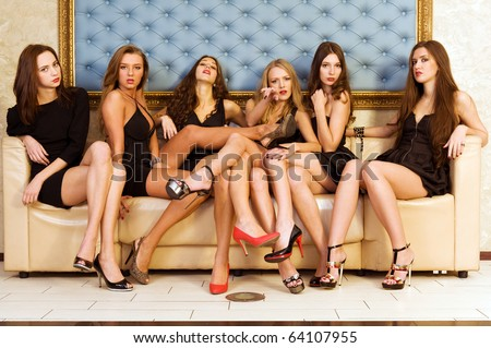 Group of the beautiful model in a black dresses - stock photo
