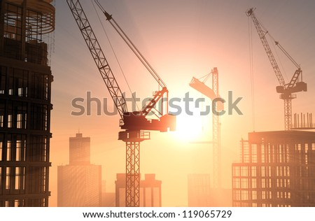 Group of the builders on the building crane - stock photo