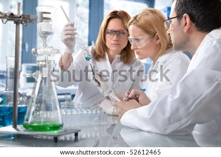 group of the students working at the laboratory - stock photo