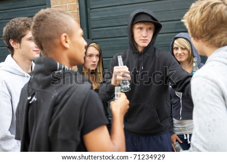 Group Of Threatening Teenagers Hanging Out Together Outside Drinking - stock photo