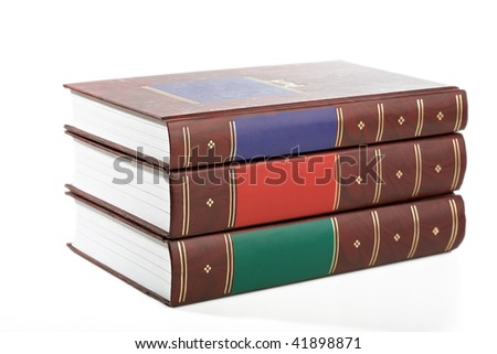 Group of three ancient books in colour cover isolated on a white background