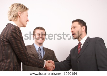 Group of  three business people - man and woman hand shake - stock photo