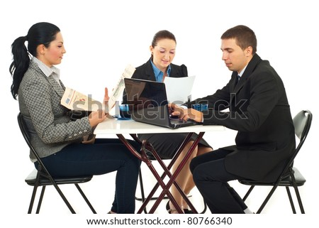 Group of three business people sitting at table in a cafe shop and reading newspaper,reading documents or searching on laptop isolated on white background - stock photo