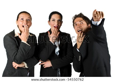 Group of three business people  with surprised face standing in a row  looking up and pointing somewhere - stock photo