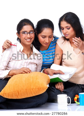 group of three college student studying together