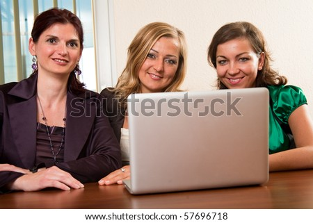Group of three confident business women make a successful team