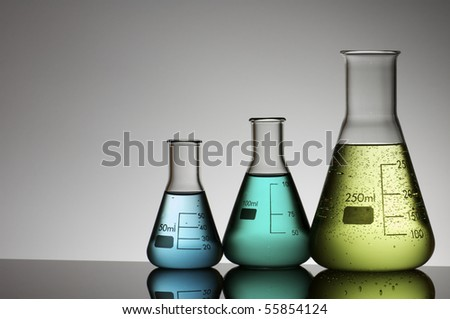 group of three conical flasks containing liquid - stock photo