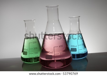 group of three conical flasks on a white lab