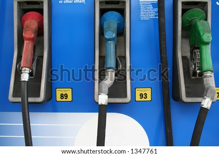 Group of three different gas pumps - stock photo