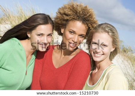 Group of three female friends at beach - stock photo
