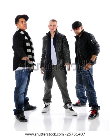 Group of three hip hop dancers standing over a white background - stock photo