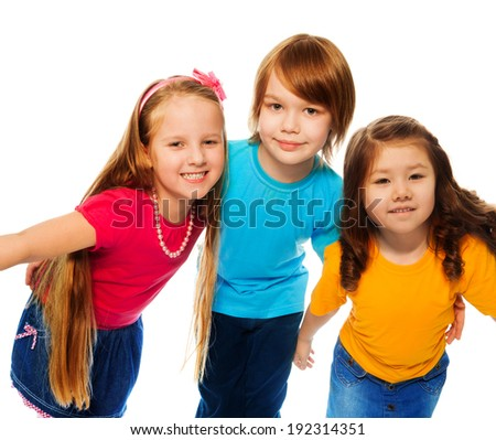 Group of three kids, two girls and boy together, Asian and Caucasian happy, hugging, isolated on white