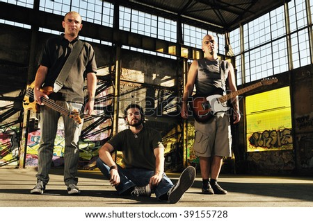group of three man outdoor with music instruments representing urban and everyday city life scene