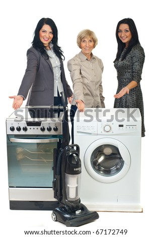 Group of three sales women showing with their hands to household appliances
