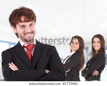Group of three smiling businesspeople in the office - stock photo