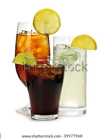 Group of three soft drinks in various glasses with garnish - stock photo