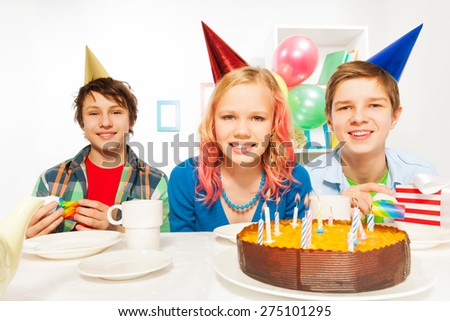 Group of three teens celebrating birthday