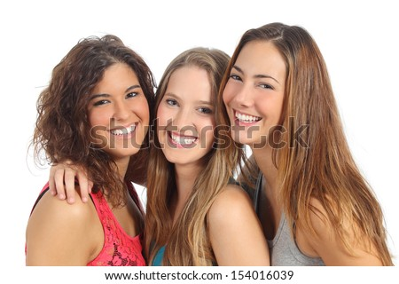 Group of three women laughing and looking at camera isolated on a white background - stock photo