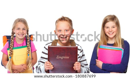 group of three young schoolchildren - stock photo