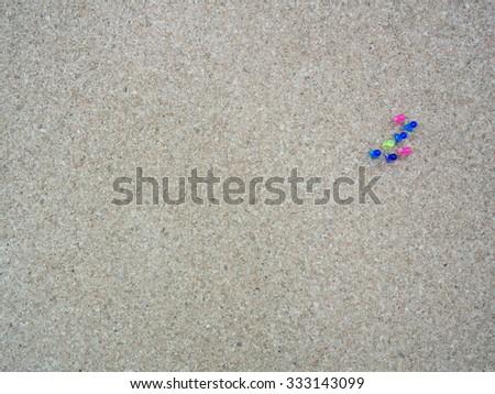 Group of thumbtacks pinned on cork board (bulletin board) - stock photo
