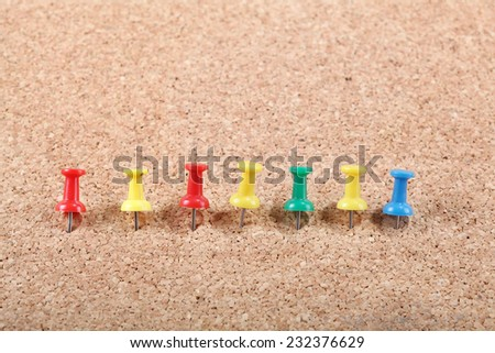 Group of Thumbtacks Pinned on empty Corkboard - stock photo
