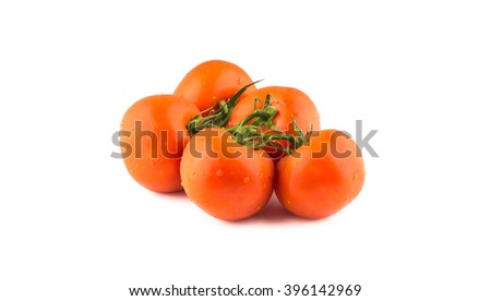 Group of tomatoes on a branch