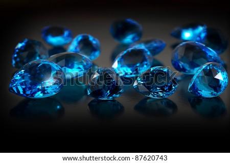 Group of topaz gemstones on dark background. - stock photo