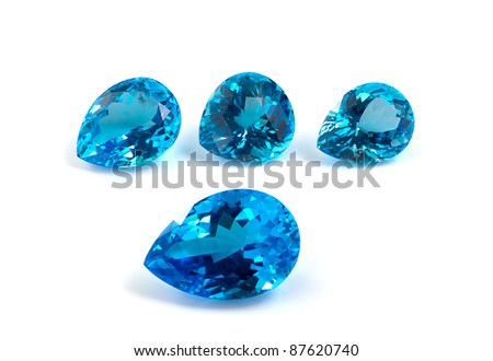 Group of topaz gemstones on white. - stock photo