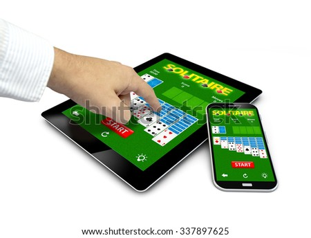 group of touchscreen devices with solitaire app and a hand touching the screen isolated on white background. All screen graphics are made up - stock photo