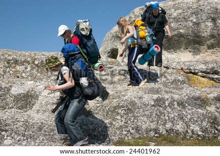 group of tourist girls hiking in the mountains