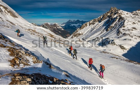 Group of tourist hiking in winter mountains - stock photo