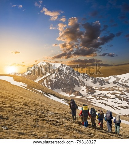 group of tourists in a hike - stock photo