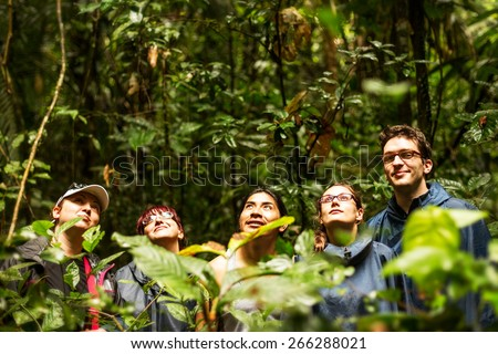 Group of tourists in Ecuadorian jungle looking for animals in Cuyabeno Wildlife Reserve, Sucumbios Ecuador - stock photo