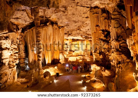 group of tourists visiting Cango Caves in Oudtshoorn, Western Cape, South Africa - stock photo