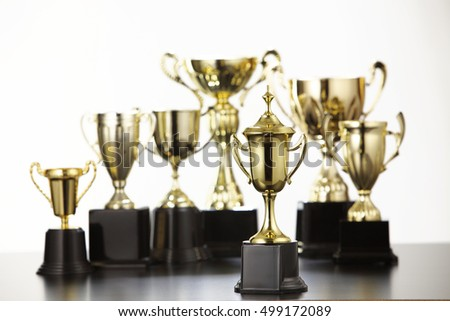 group of trophy on the black table top