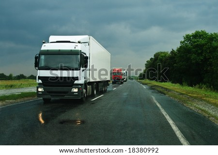 Group of trucks on wet asphalt after rain