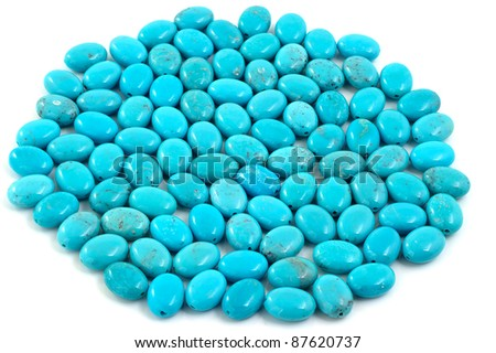 Group of turquoise beads on white. - stock photo