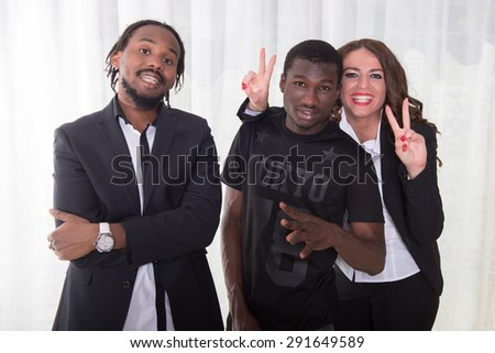 group of two africans and one caucasian girl - stock photo