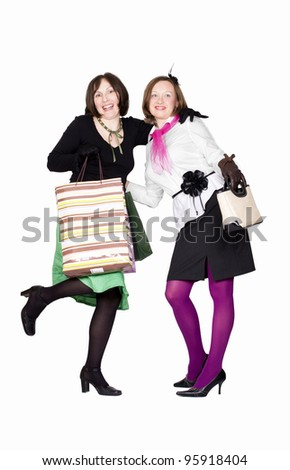 Group of two happy adult women out of shopping with colored bags. Isolated on white. - stock photo