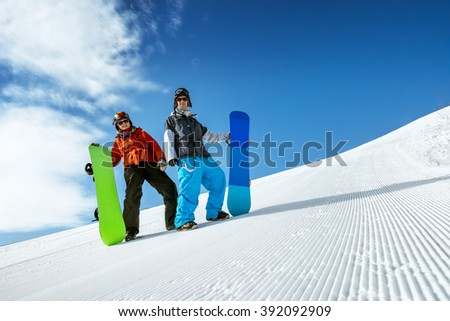 Group of two snowboarders standing on the slope prepared by snowcat. Sheregesh resort, Siberia, Russia - stock photo